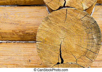 Round wooden log of house wall
