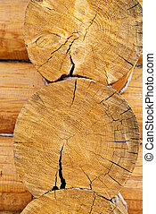 Round wooden logs of house wall