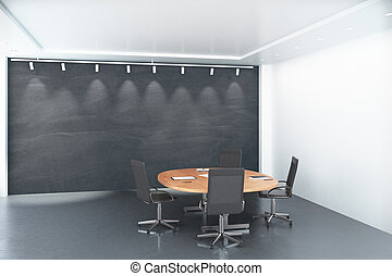 Round wooden table with chairs with blank big blackboard in conference room