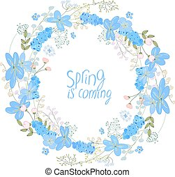 Round wreath made of blue primroses - muscari and hepatica. ...