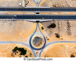 Roundabout and the desert road aerial view