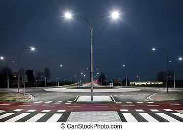 Roundabout illuminated by led lights in the twilight zone.