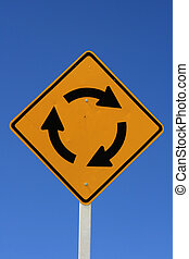 roundabout road sign with blue sky background