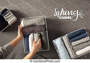 roupas, primavera, closet., neatly, limpeza, cinzento, branca, experiência., cestas, metal, wardrobe., arrumar, vertical, dobrado, storage., cima