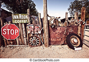 Old Route 66 rusty cafe and motel signs in desert of Arizona