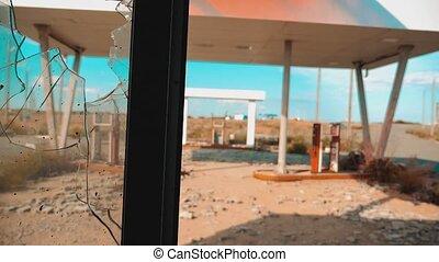 Route 66. crisis road 66 fueling broken window slow motion...