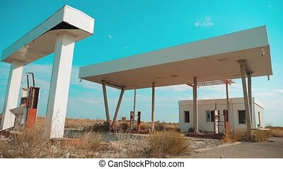 Route 66. crisis road 66 fueling slow motion video. Old dirty deserted gas station. U.S. closed supermarket store shop Abandoned gas station oil end of fuel the world apocalypse petrol. main street of america. mother of the roads. mother of lifestyle the roads