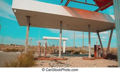 Route 66. crisis road 66 fueling slow motion video. Old dirty deserted gas station. U.S. lifestyle closed supermarket store shop Abandoned gas station oil end of fuel the world apocalypse petrol. main street of america. mother of the roads. mother of the roads