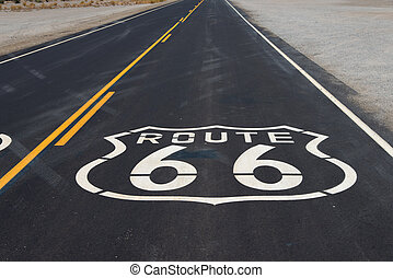 Route 66 highway shield painted on road in California