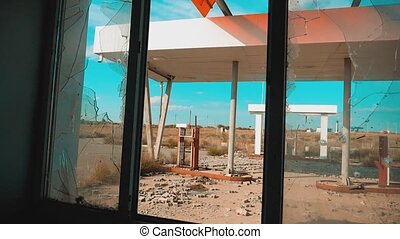 Route 66. lifestyle crisis road 66 fueling broken window slow motion video. Old dirty deserted gas station. U.S. closed supermarket store shop Abandoned gas station oil end of fuel the world apocalypse petrol. main street of america. mother of the roads. mother of the roads
