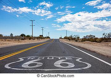 Route 66 Sign on the asphalt, California Mojave Desert, USA