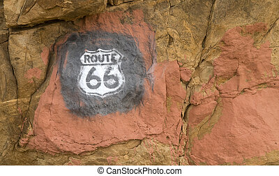 Route 66 sign painted on rocks in New Mexico