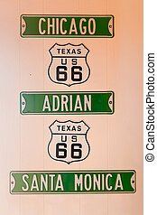Route 66 signs including Chicago, Adrian and Santa Monica