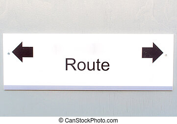 Route direction notice board  on wooden background