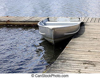Row Boat - Row boat tied to the dock