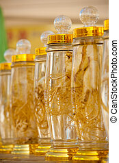 Ginseng, an ancient oriental medicine, is displayed in bottled preserved form.