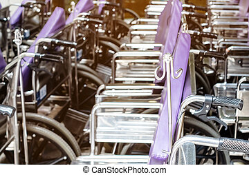 Row in line of wheelchairs in the hospital or medical clinic, Healthcare and medical service concept. Selective focus.