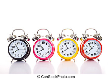 Row Of Alarm Clocks on WHite