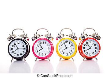 Row Of Alarm Clocks on WHite