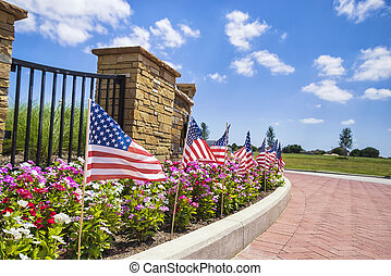 American flags displayed on the street side