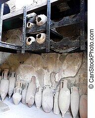 Row of amphorae at the ancient Roman city of Herculaneum, Italy