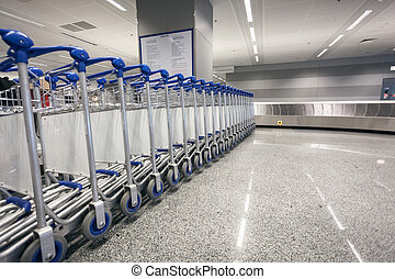 baggage trolleys at arrival terminal in airport