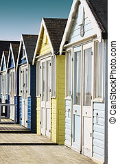 Row of Beach Huts - Front view of a row of wooden beach huts...