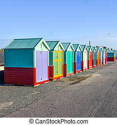 Row of beach huts on sea front in England