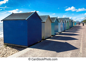 Row of beach huts on the sand