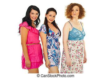 Row of beautiful women - Row of three beautiful women in...