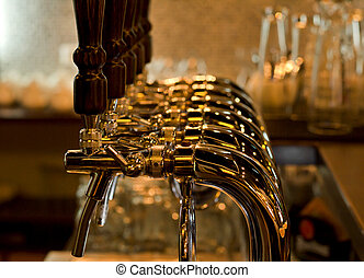 Row of beer taps in a pub or bar