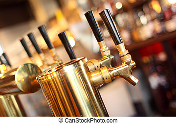 Row of beer taps in a tavern.