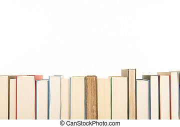 Row of books on a white background with space for copy