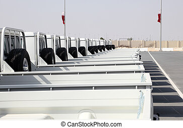 Row of brand new pickup trucks in Qatar, Middle East
