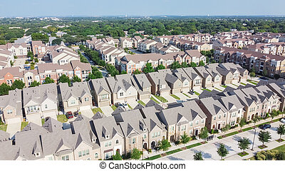 Row of brand new townhomes and apartment complex in downtown Flower Mound, Texas, USA