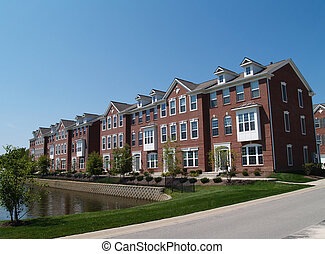 Row of Brick Condos With Bay Window