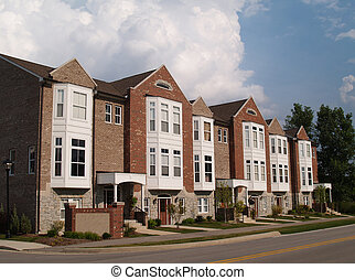 Row of Brick Condos With Bay Window - A row of brick condos...