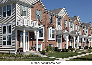 Row of brick townhouses with covered entries