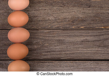 Row of Brown Eggs