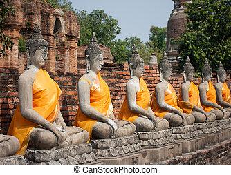 Row of Buddha statues at Ayutthaya, Thailand.