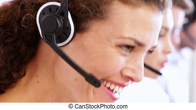 Row of call centre agents working a