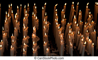 Row of candles on a black background