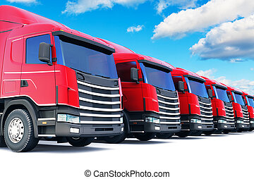 Row of cargo trucks against blue sky