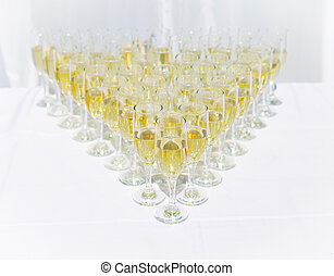 Row of champagne glasses on a table