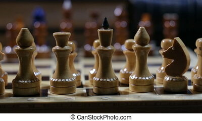 row of chess figures close to - row of chess figures on a...