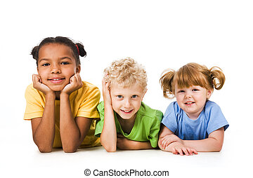 Row of children smiling and resting together
