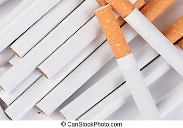 row of cigarettes on white backgrou