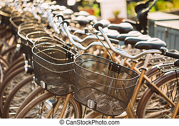 Row of city parked bicycles bikes for rent on sidewalk. Bike...