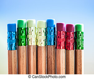 Row of color pencils on blue  background.Studio shot