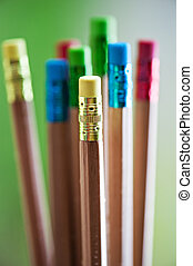 Row of color pencils on green  background.art.Creativity